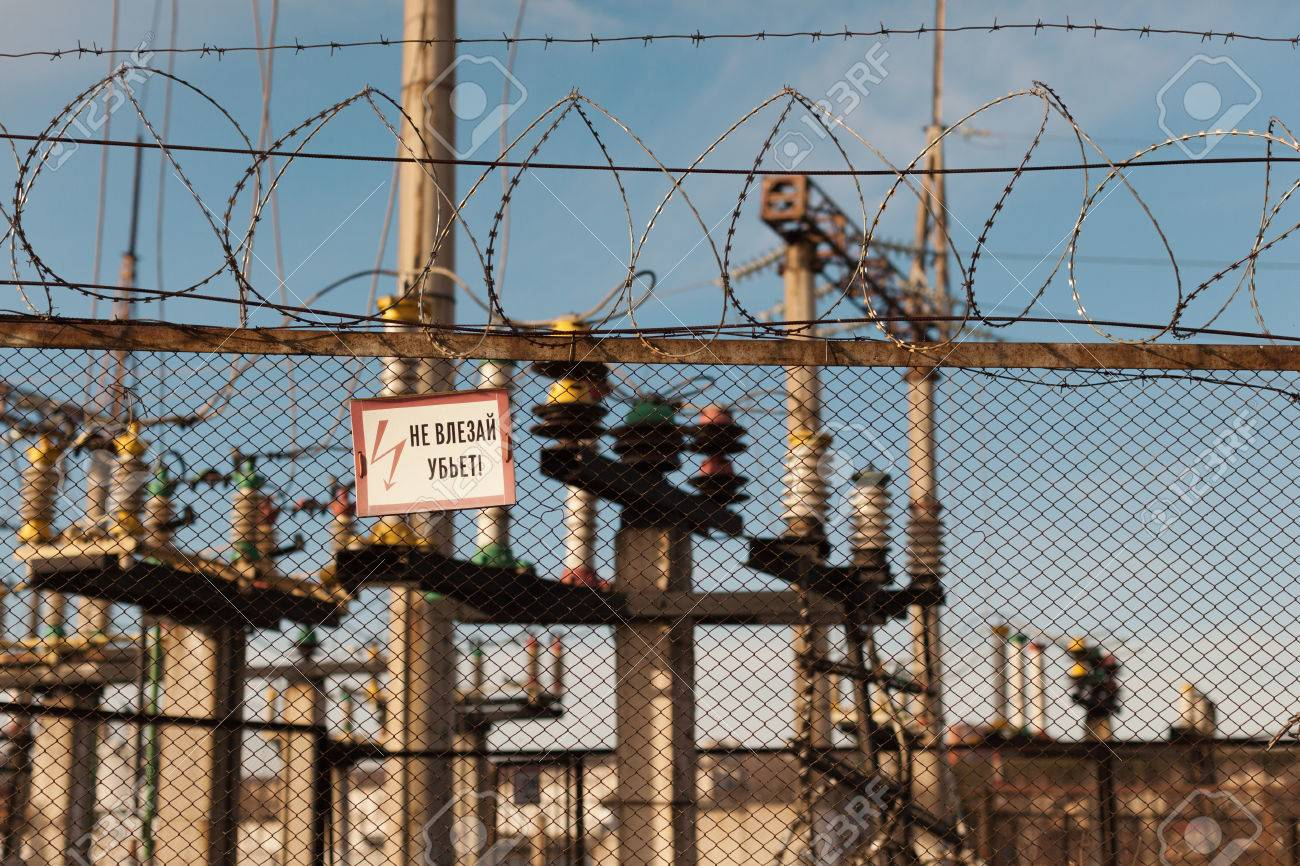 High-voltage Transformer Substation Behind Barbed-wire Chain-link ...