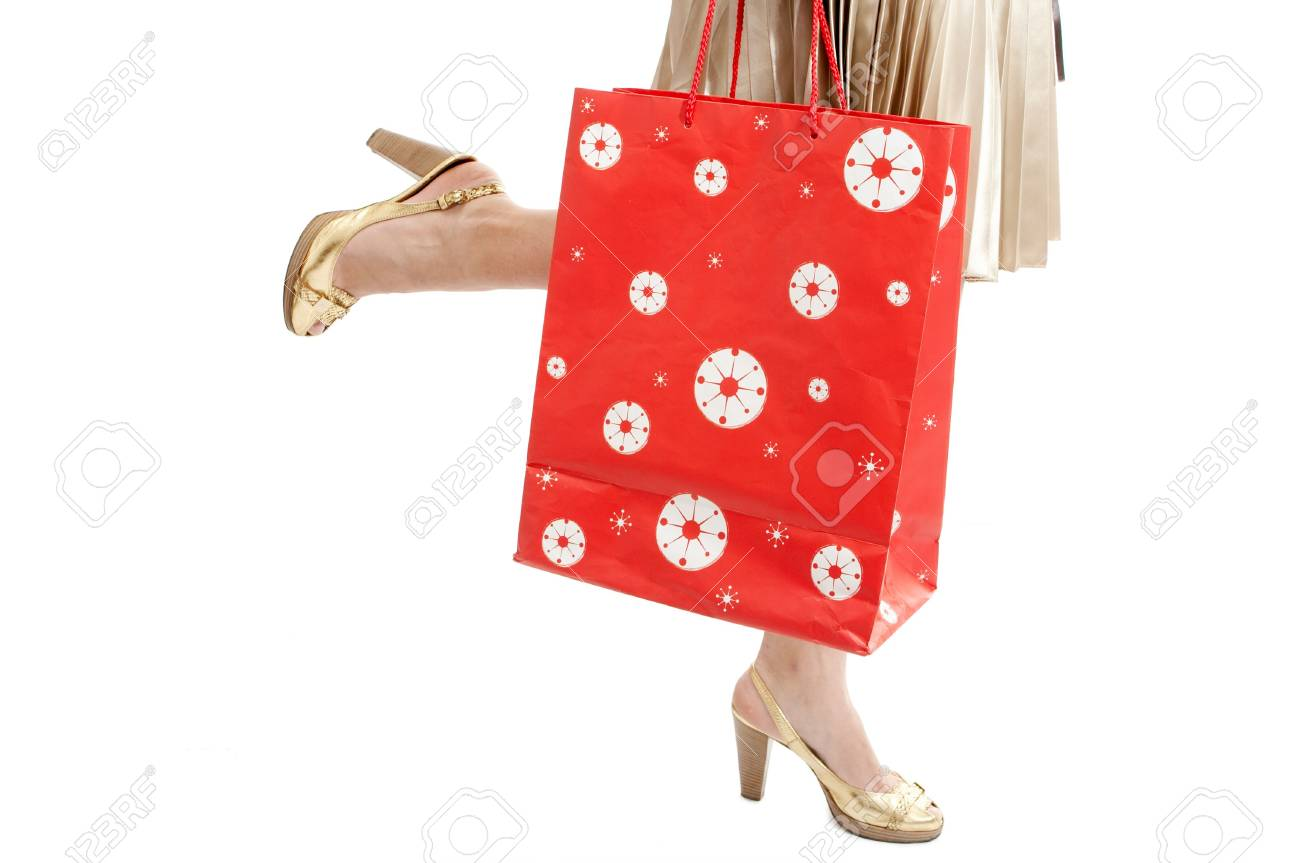 woman legs with packet run shopping on white Stock Photo - 2711469