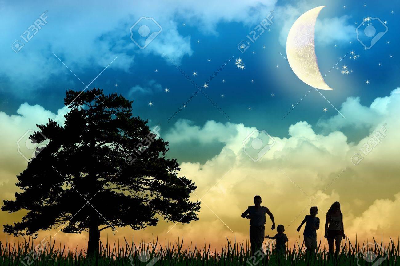 family walk field with tree moon night Stock Photo - 3289033