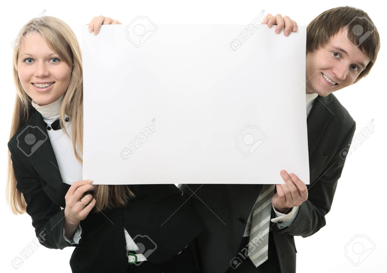 Two young people holding a white sign  on white background Stock Photo - 5526297