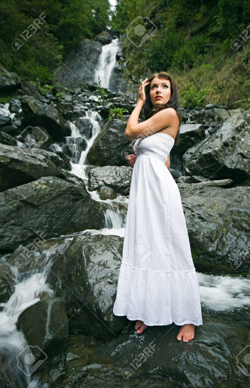 beauty woman on waterfall in Abkhazia forest Stock Photo - 8361147