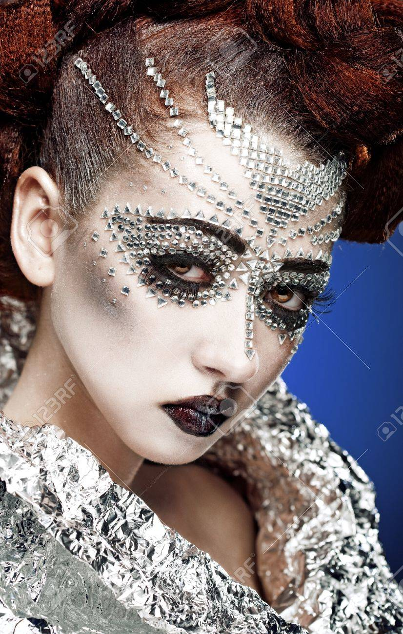beauty woman makeup with crystals on face on blue background Stock Photo - 9759786