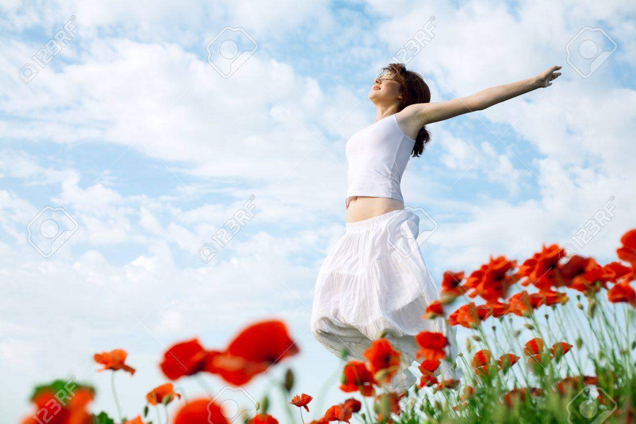 beauty woman in poppy field in white dress Stock Photo - 9759237