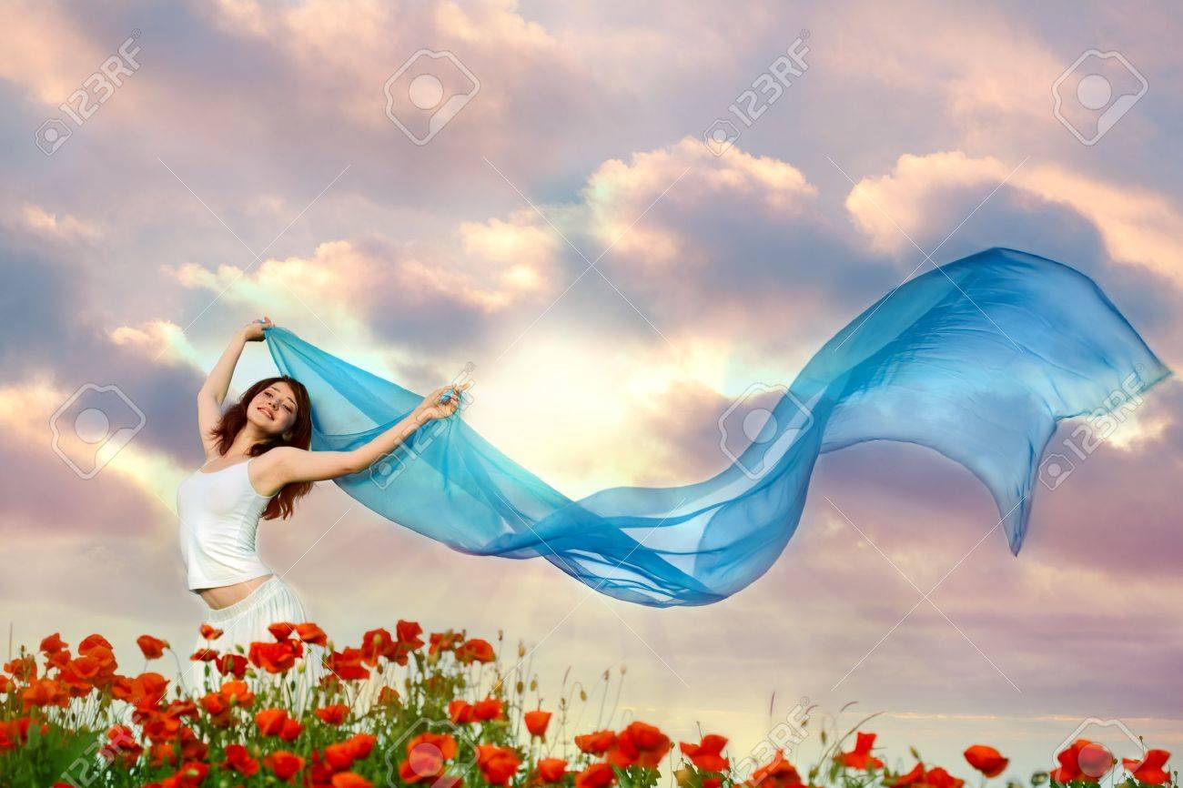 beauty woman in poppy field with blue tissue under sky Stock Photo - 9759272