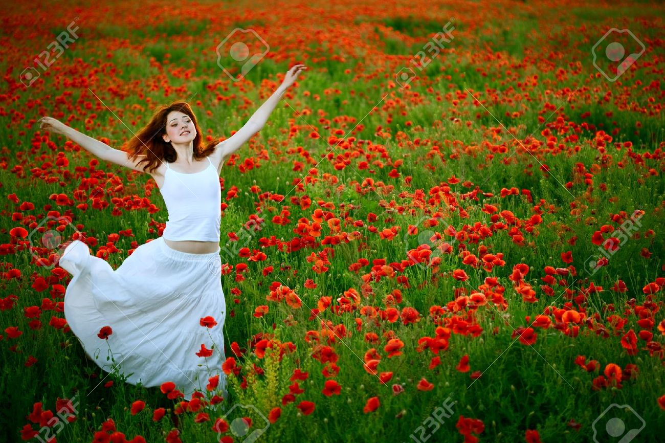 Poppy flower field at night royalty free stock photography image - Beauty Woman In White Dress Running Poppy Field