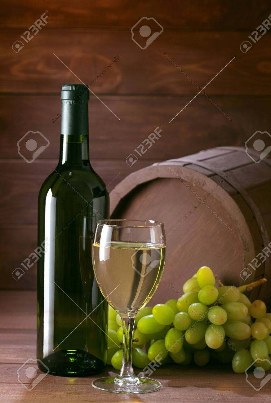 bottle of vine on  wooden background Stock Photo - 13339561