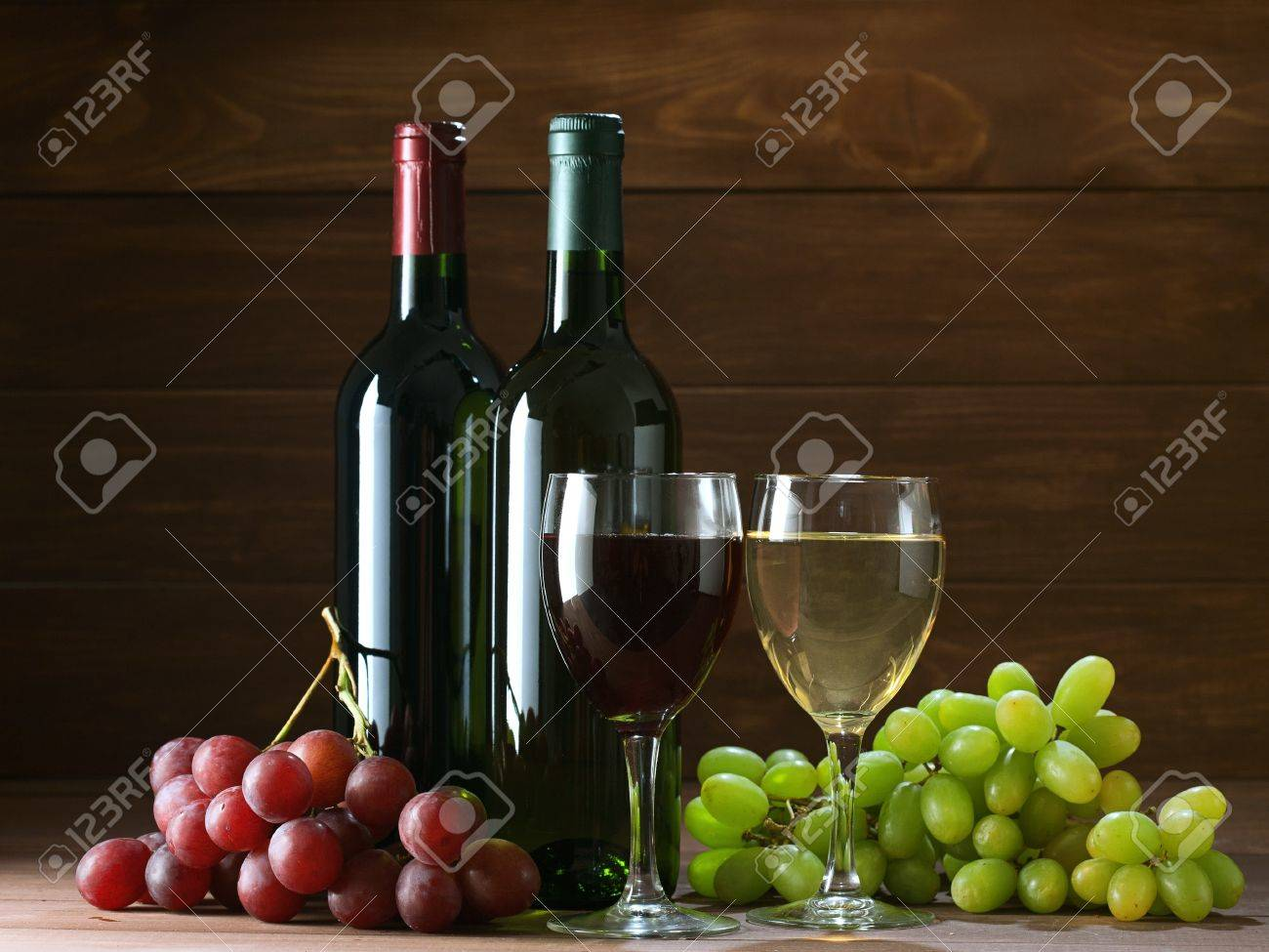 bottle of vine on  wooden background Stock Photo - 13339557