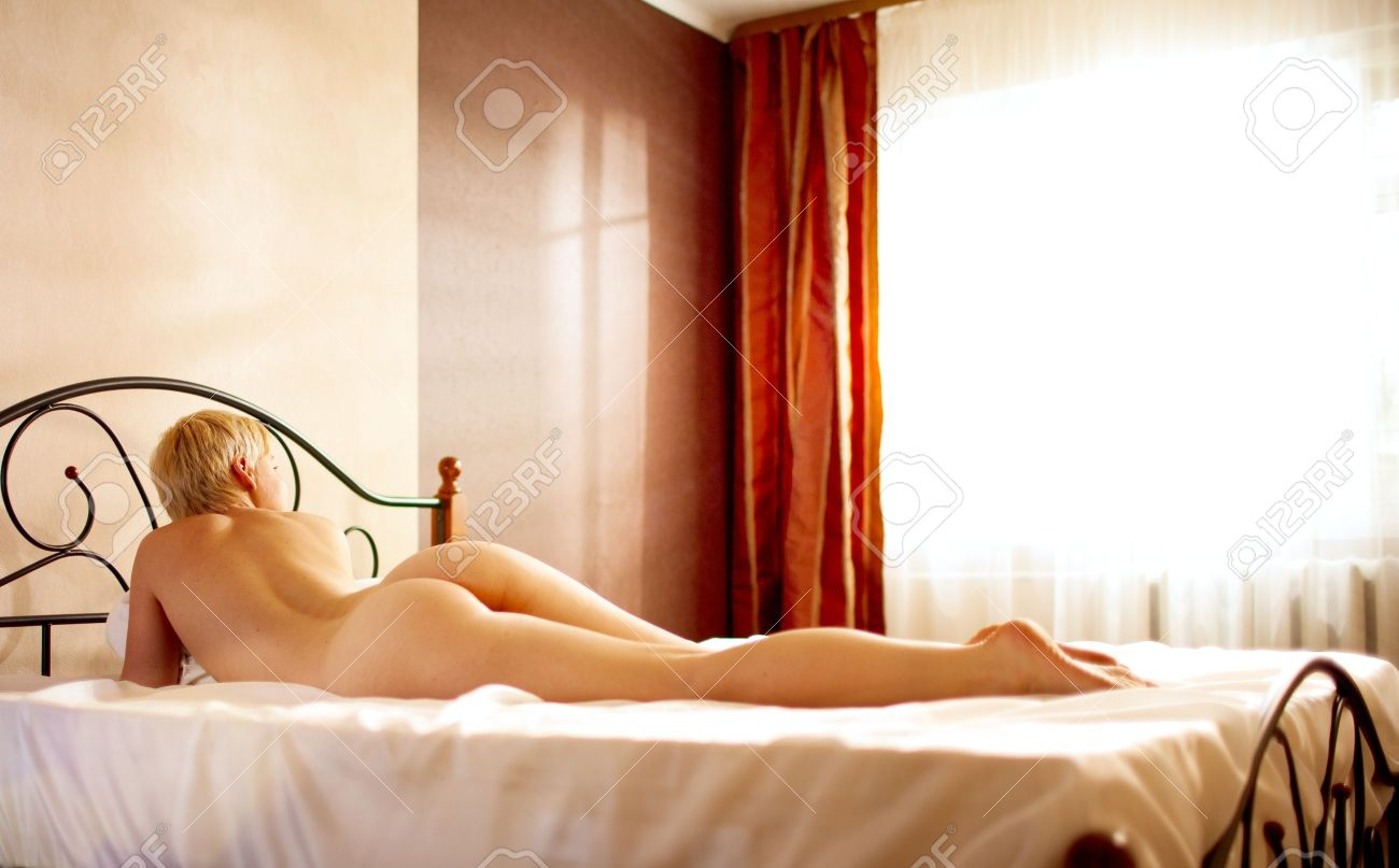 young gay lie on the bed Stock Photo - 13339473