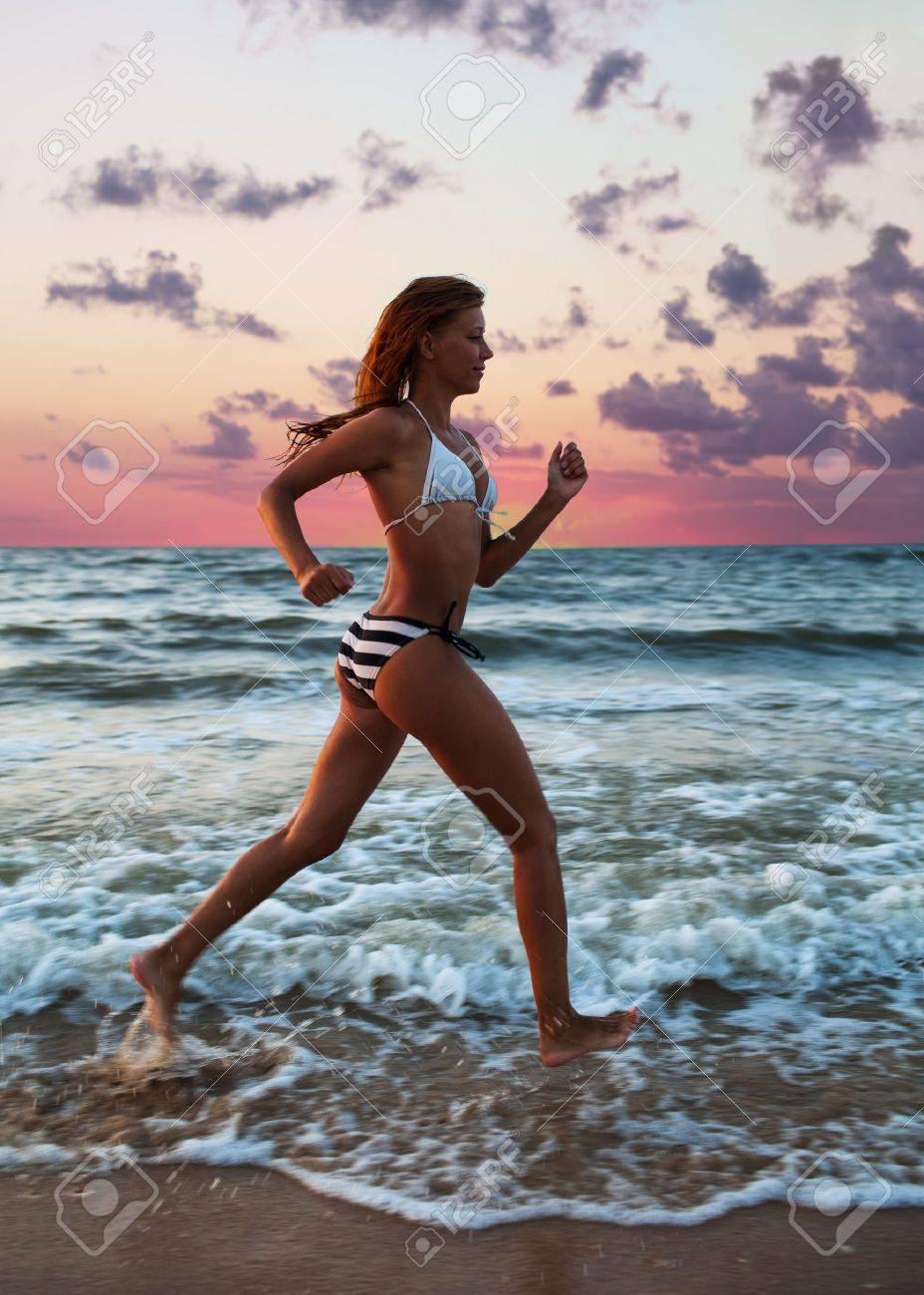 girl runs along the shore of the sea Stock Photo - 21351827