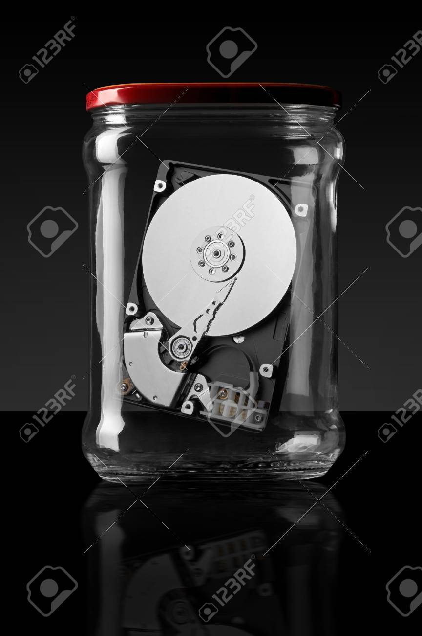 Computer hard disk in a glass jar on a black background Stock Photo - 4624305