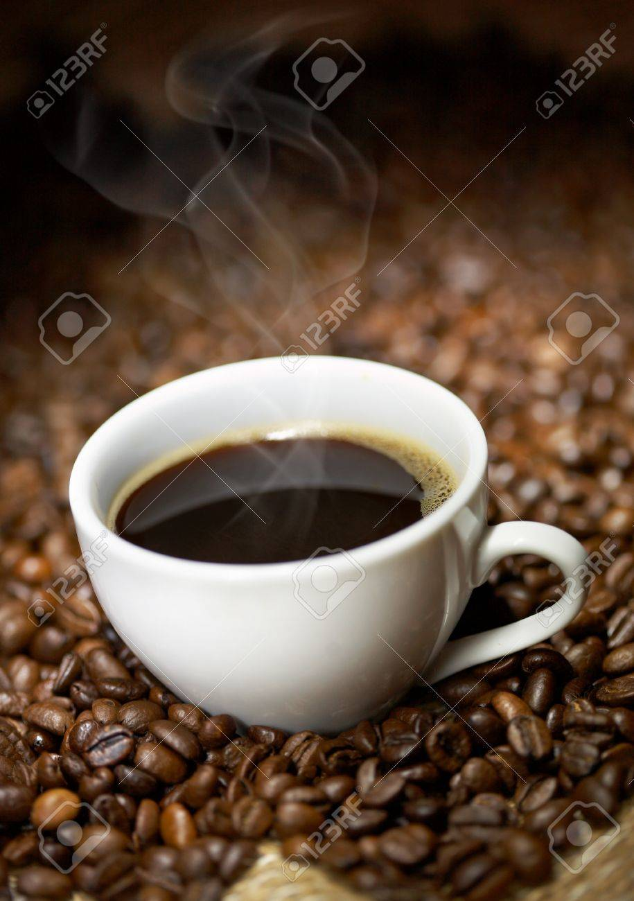 Coffee cup with roasted beans background Stock Photo - 9458987