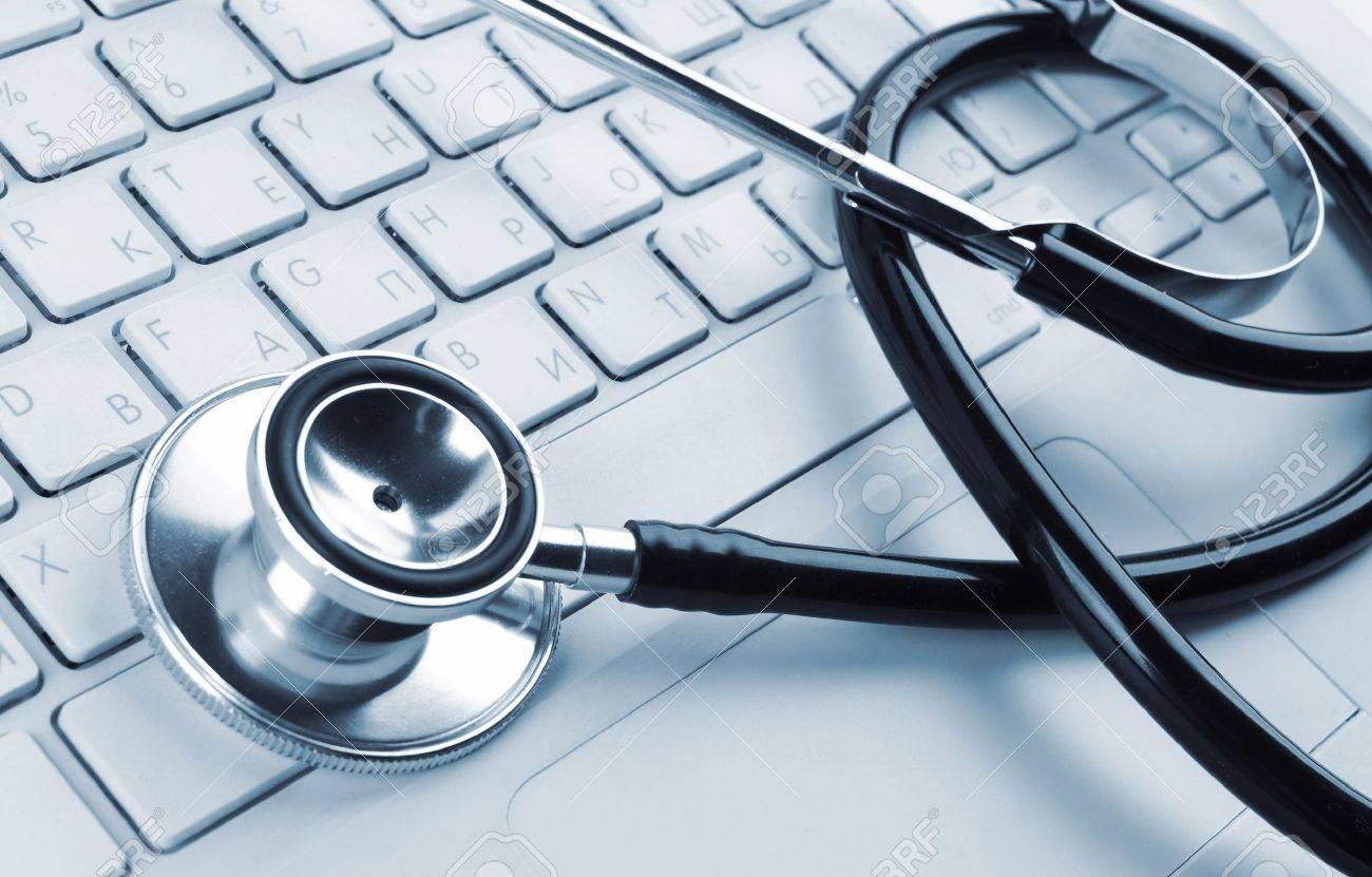 stethoscope on a white laptop computer Stock Photo - 11724035
