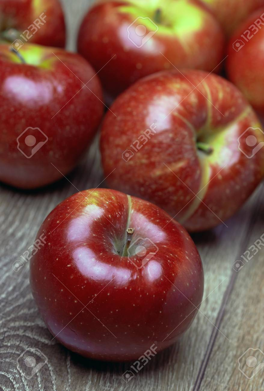 Fresh Red Apples on the wooden table Stock Photo - 19047694
