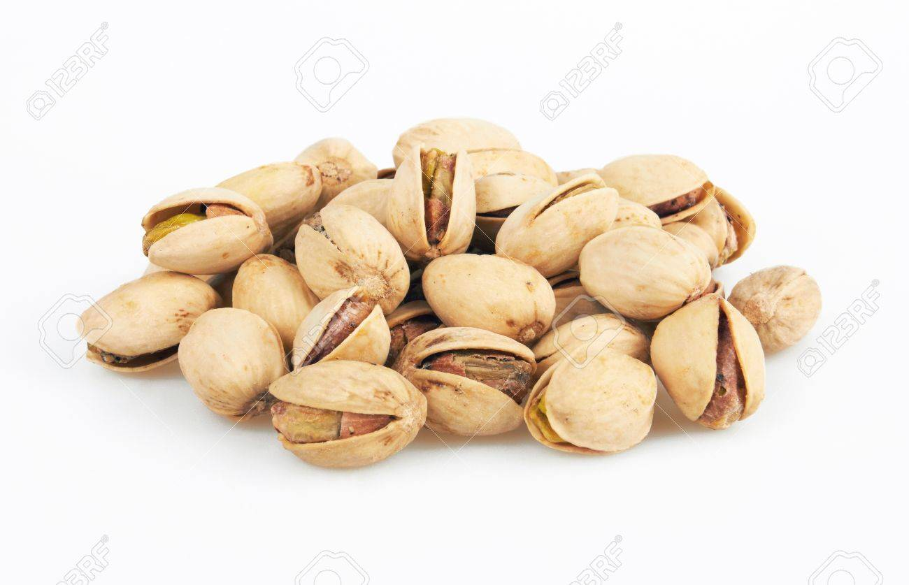 pistachios heap isolated on white background - 19047704