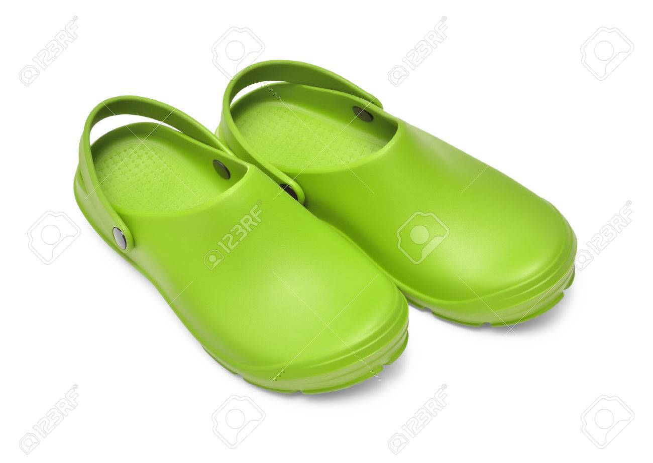 b04ad6089b1b9 Crocs shoes. A pair of green clogs isolated on white background w  path  Stock