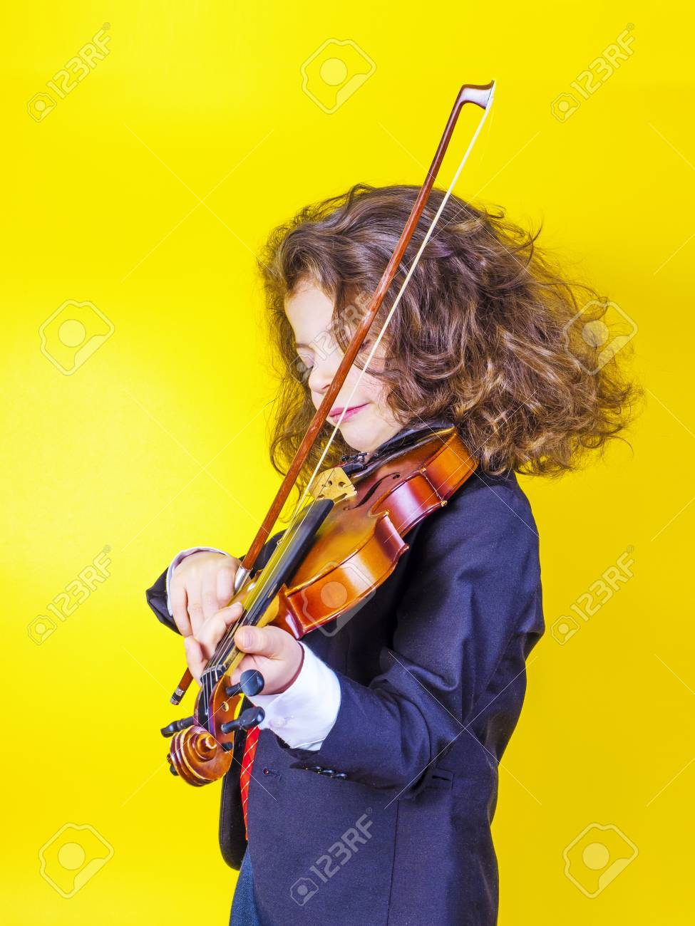 The long-haired seven-year-old boy played the violin  Musical
