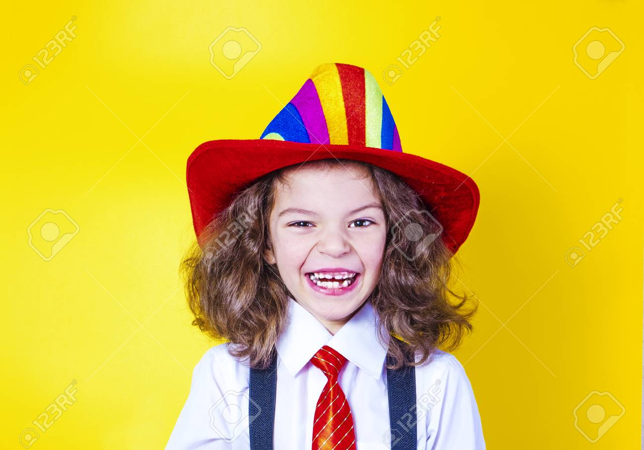 6b0a83dbb7a Portrait of a smiling little boy in a big American hat and shirt. Happy  child