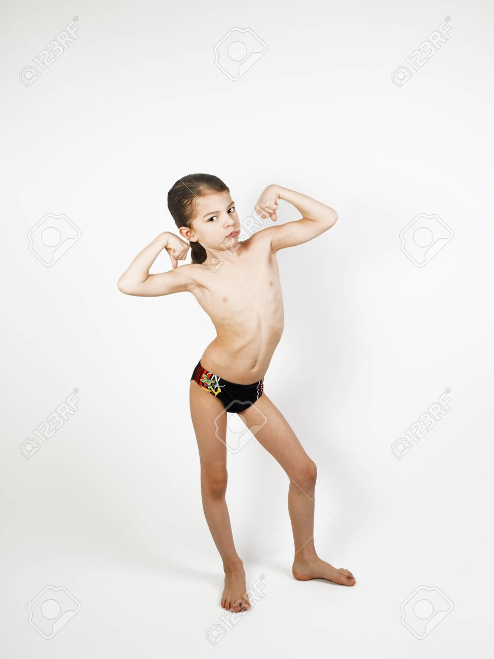 8ce89d665d831 Happy little boy triumphing with raised hands, on a light background Stock  Photo - 98290915