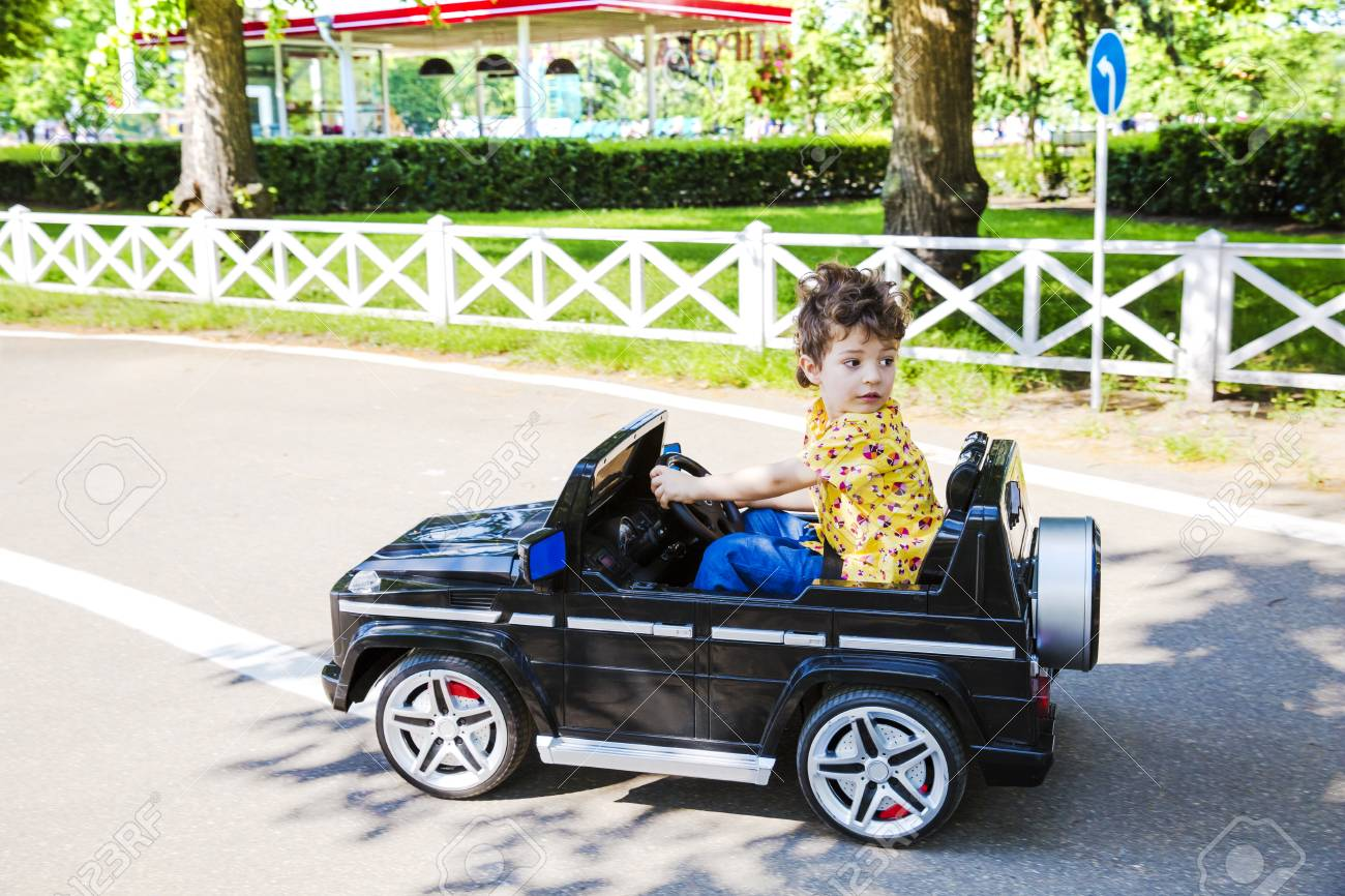 A Funny Boy Rides On A Toy Electric Car On A Sunny Summer Day Stock Photo Picture And Royalty Free Image Image 99910498