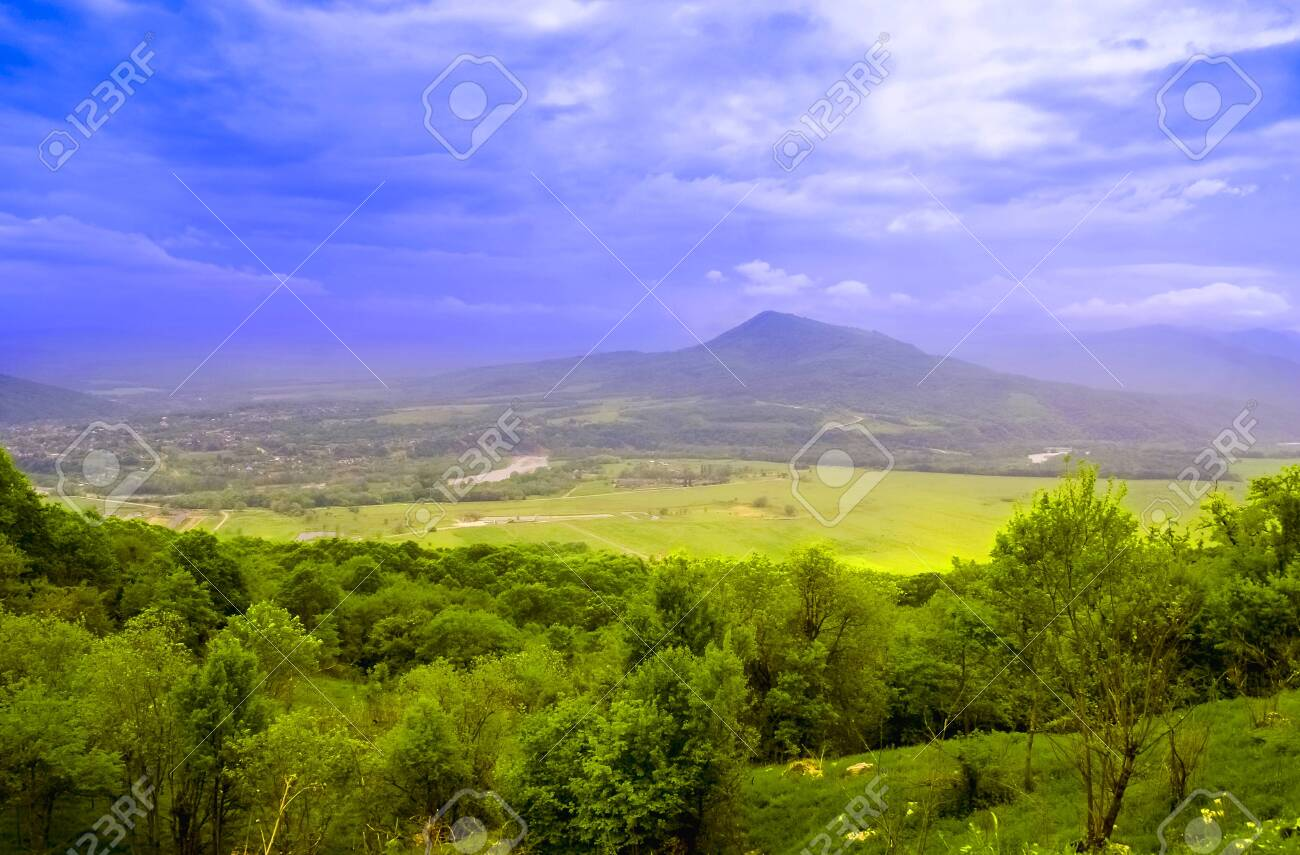 Mountain landscape in Abkhazia in the valley of Auadhara. Panorama with yellow autumn hills and mountains. The photo was taken in the valley of the seven lakes, the Republic of Abkhazia. - 122502734