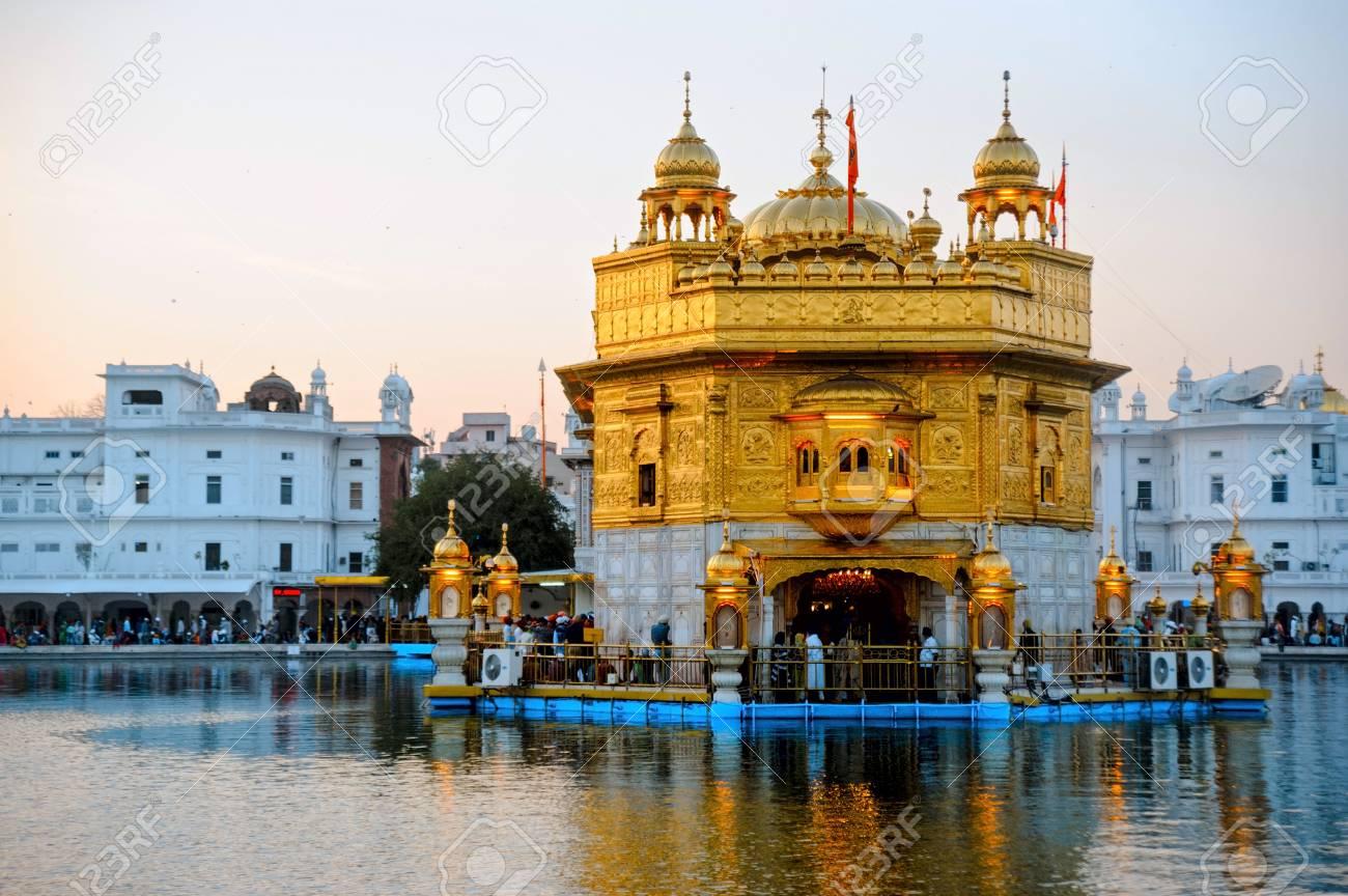 golden temple harmandir sahib at sunrise. amritsar, india stock