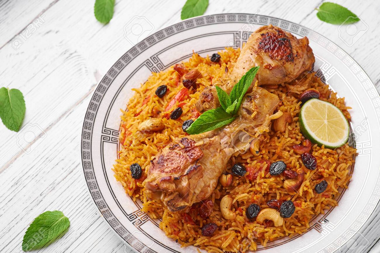 Chicken Kabsa Or Chicken Biryani At White Wooden Background Stock Photo Picture And Royalty Free Image Image 128824265