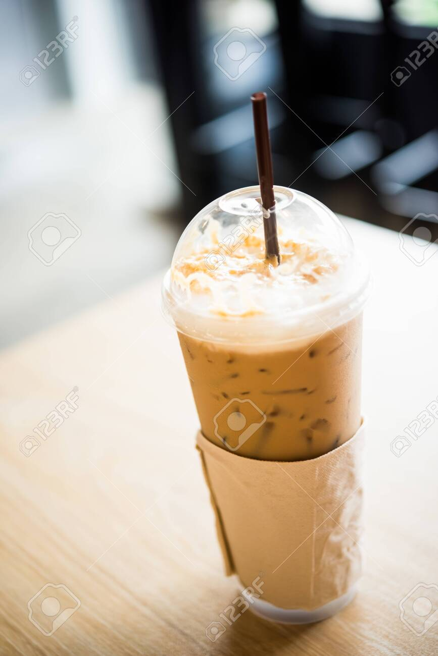 Iced coffee in a plastic cup - 123489417