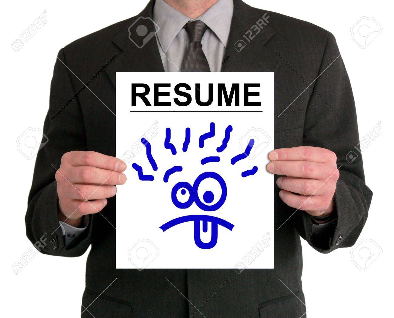 Image of a businessman's torso. He is holding a resume in front of him, with a silly cartoon face drawn on it. Stock Photo - 417575