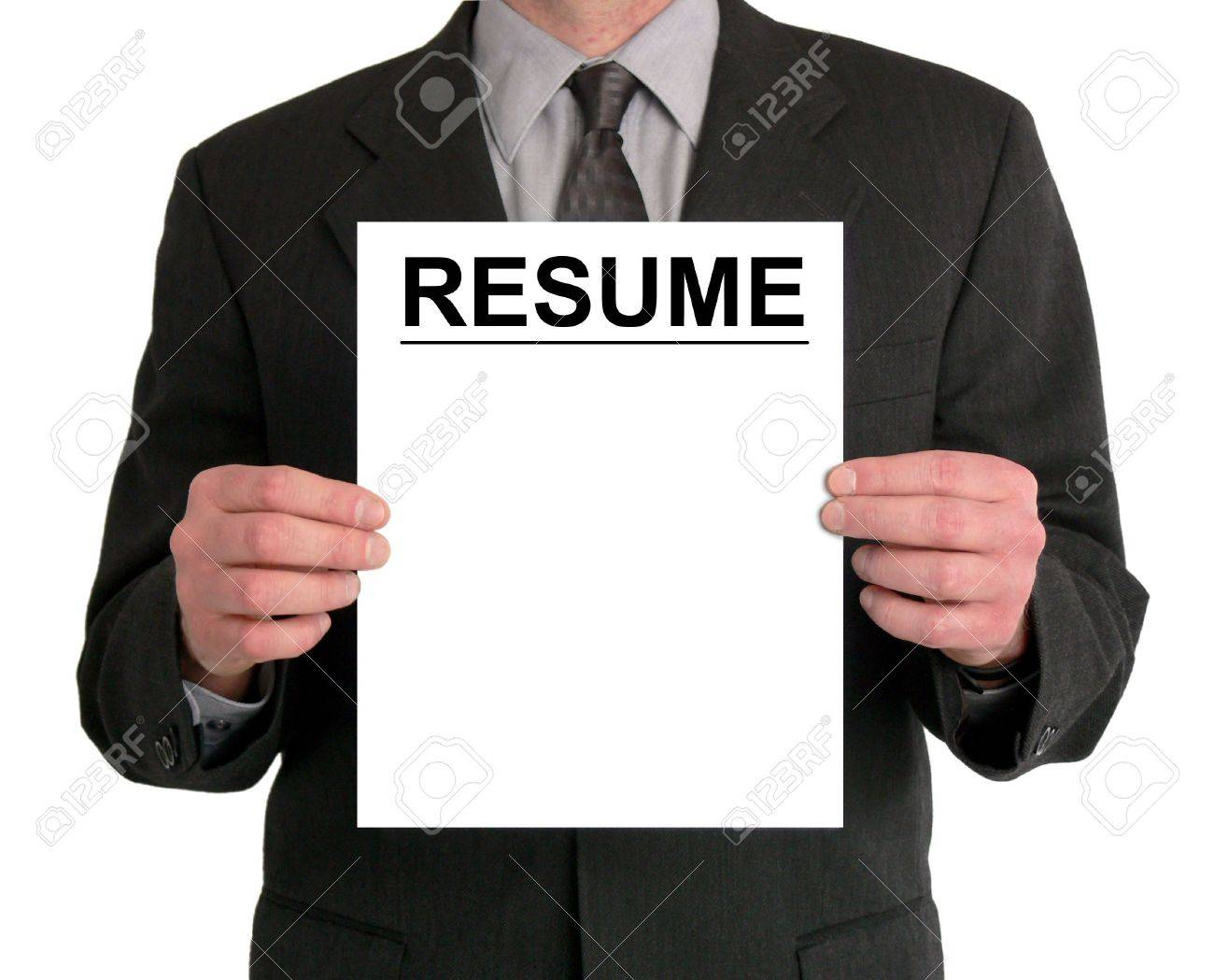 Image of a businessman's torso. He is holding a resume in front of him. Stock Photo - 417574