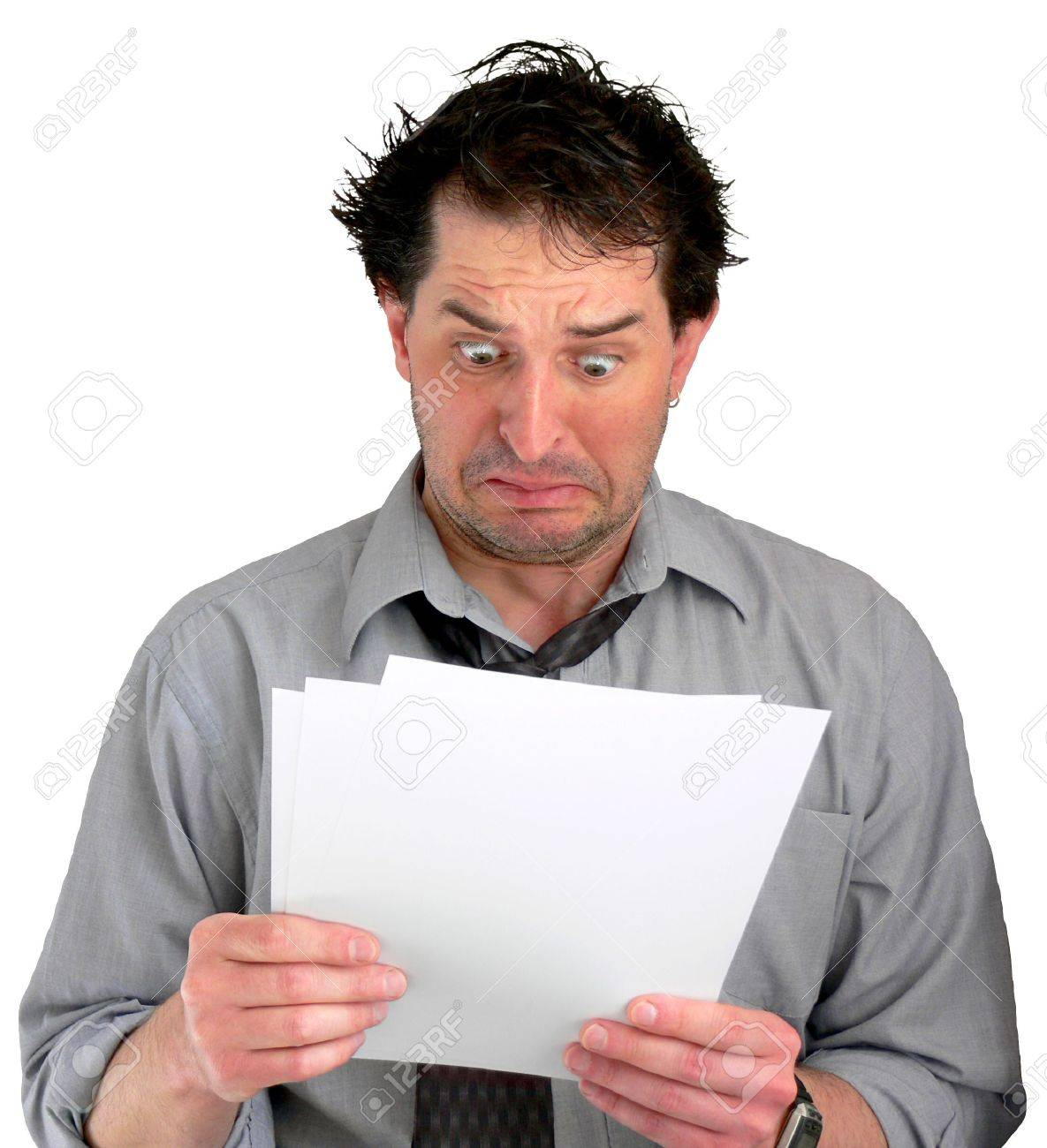 Tired, freaked-out business man reading documents. Stock Photo - 417468