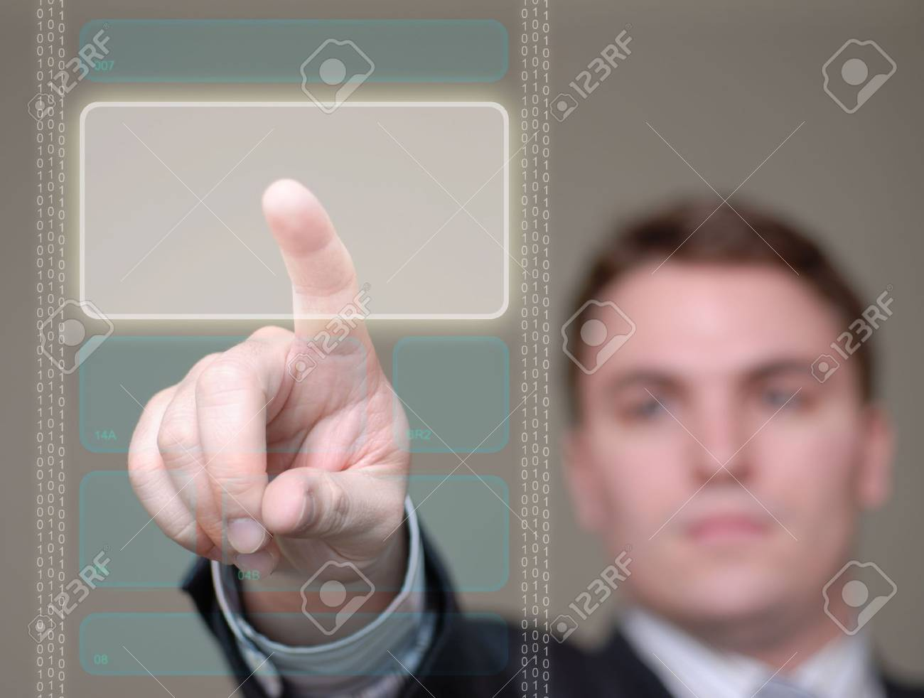 Young businessman pushing a button area on a translucent, hi-tech screen. Shallow depth of field. Stock Photo - 759935