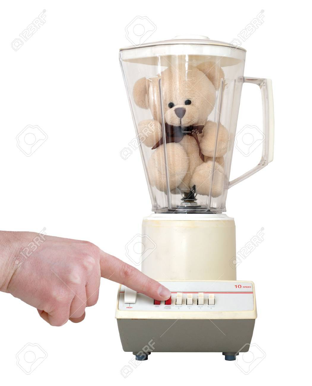 Cute little teddy bear in an old-fashioned blender, with a finger pushing the button. Isolated on a white background. Stock Photo - 759885