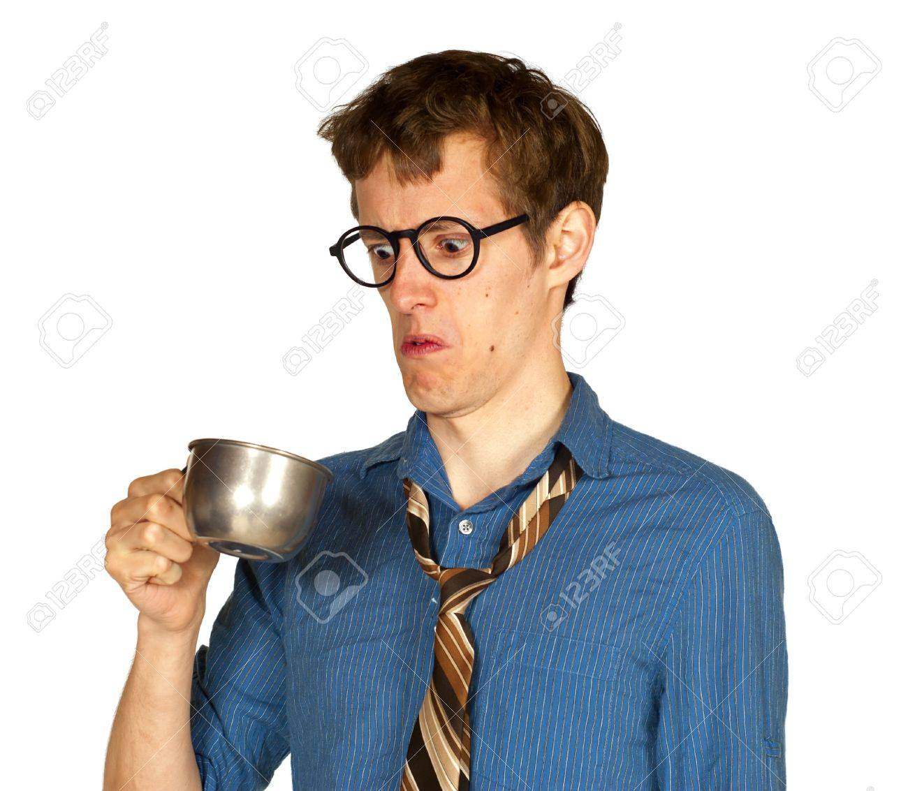 Man with glasses looking into metal cup, with look of distaste, isolated on white background Stock Photo - 14798375