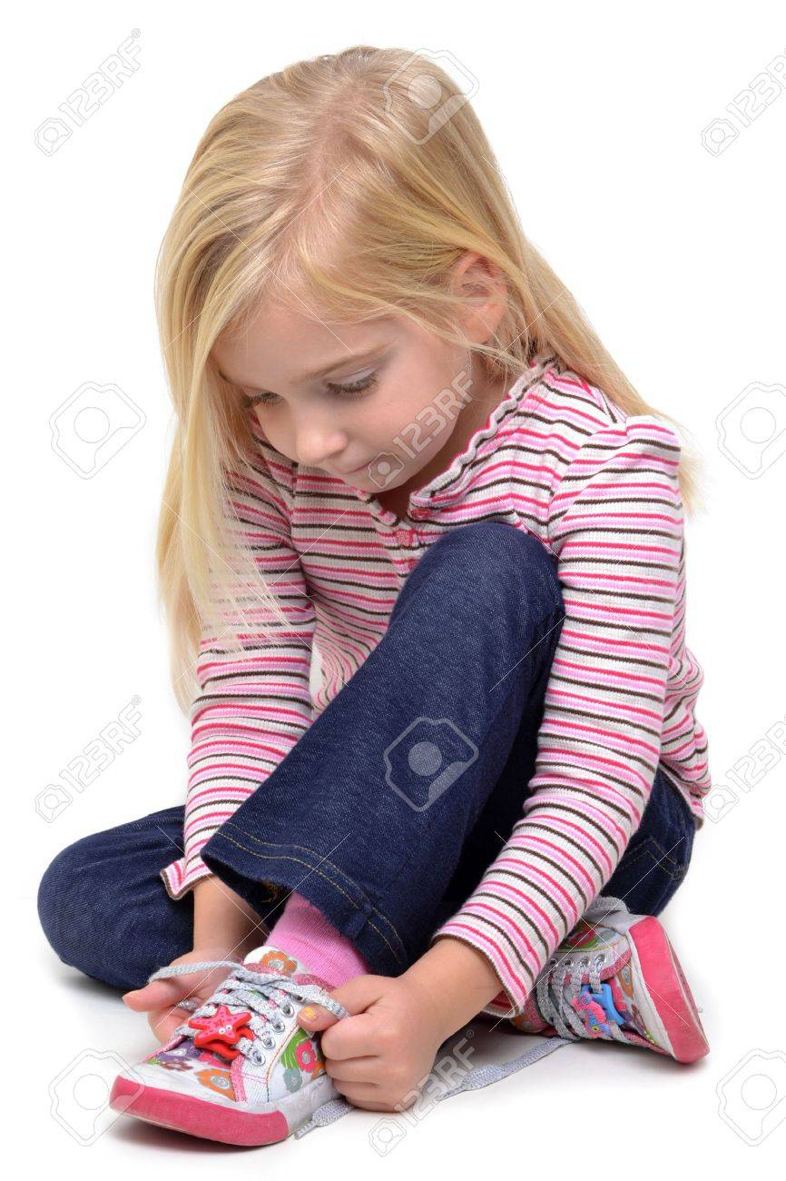girl tying her shoes Stock Photo - 11126914