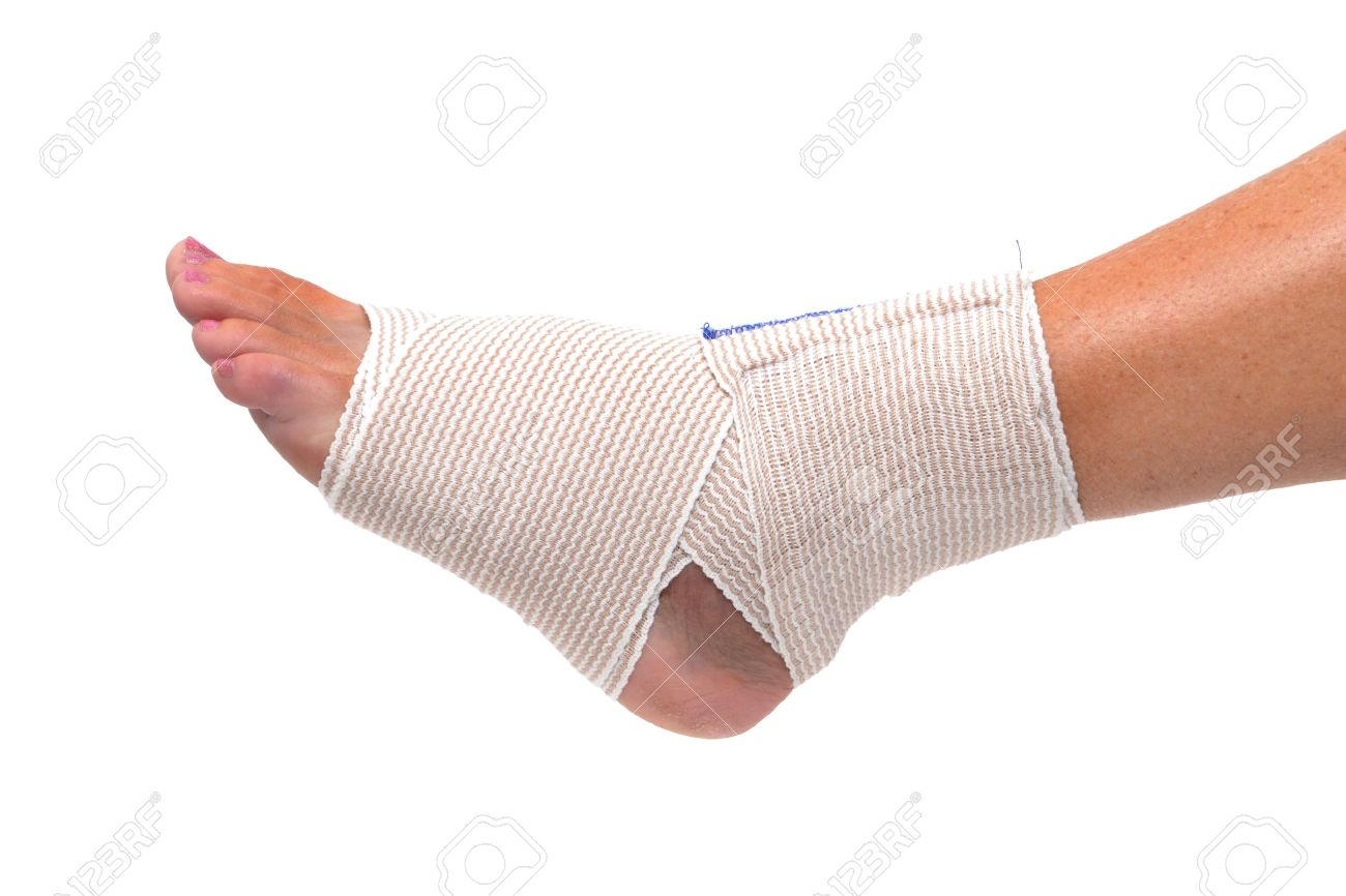 Ankle And Foot Wrapped In Bandage Stock Photo, Picture And Royalty Free  Image. Image 14245095.