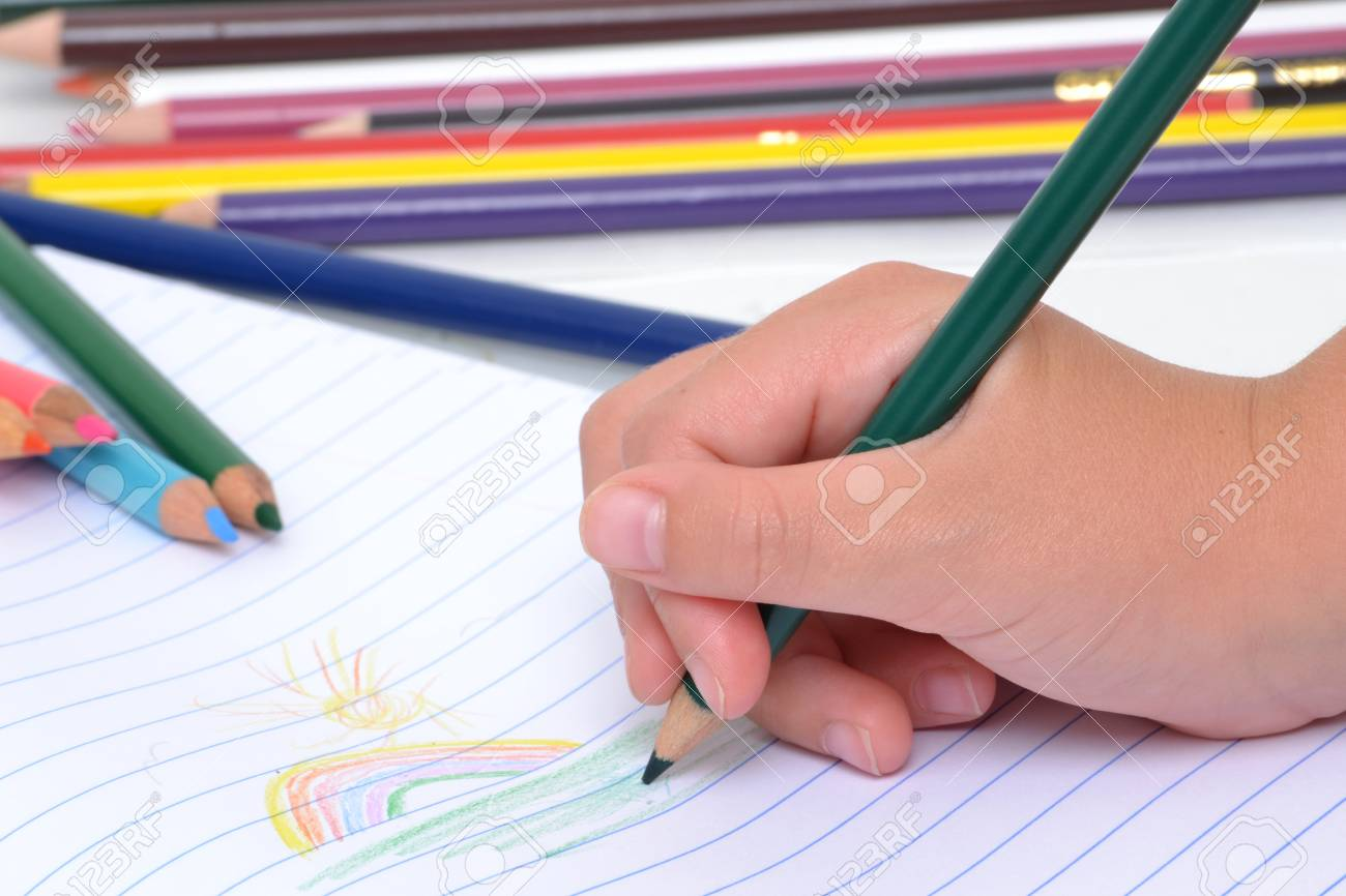 Child Coloring With Pencils Stock Photo, Picture And Royalty Free ...