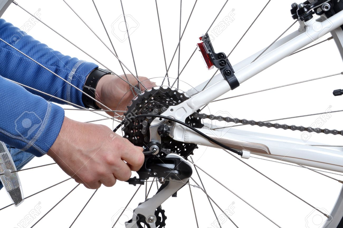 man repairing bicycle wheel Stock Photo - 17781119