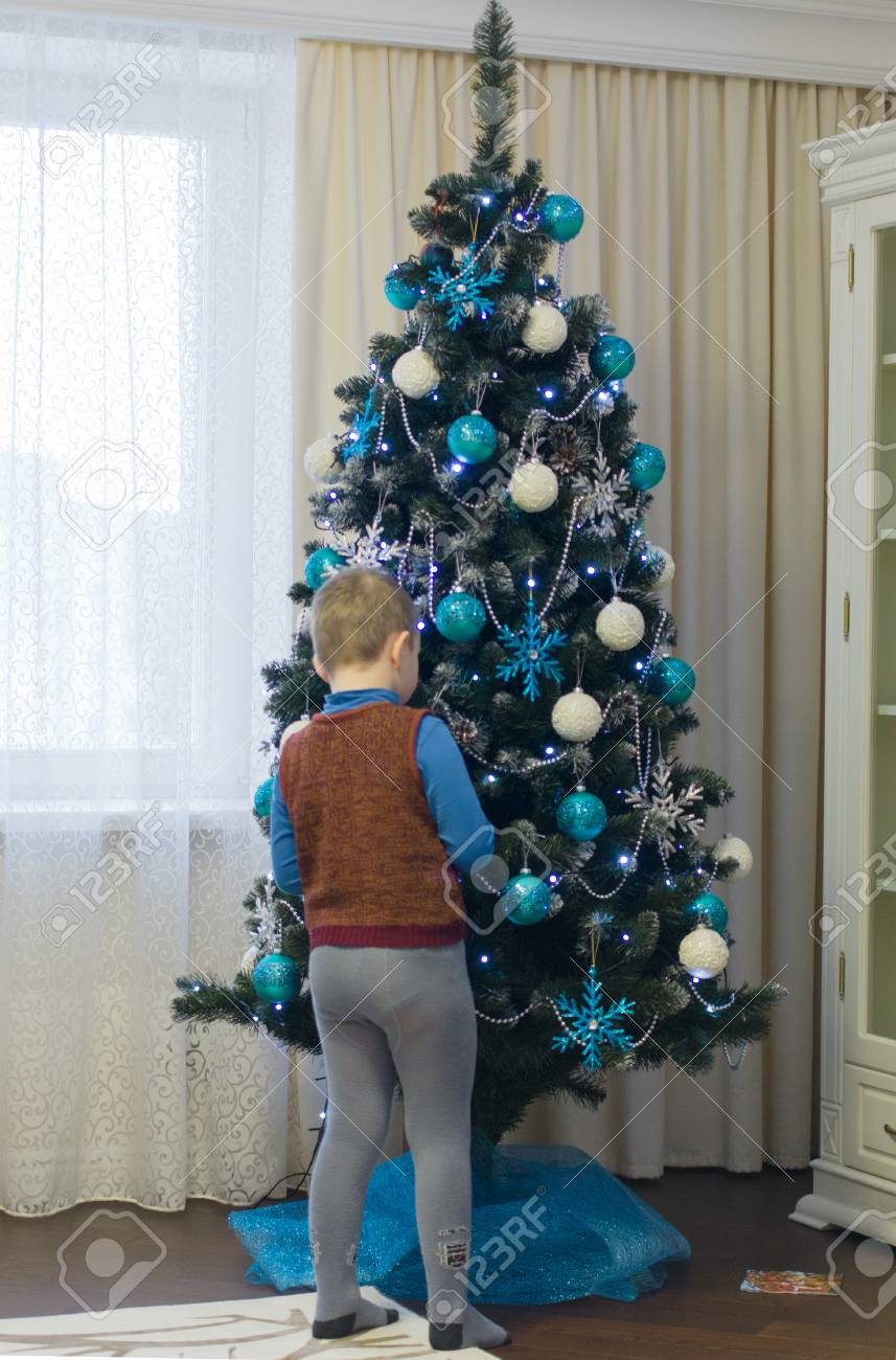 Little Boy Decorates A Christmas Tree Beautiful Christmas
