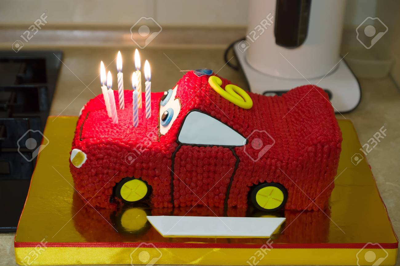 Excellent Birthday Cake Made In The Form Of A Sports Car With Candles Stock Personalised Birthday Cards Veneteletsinfo