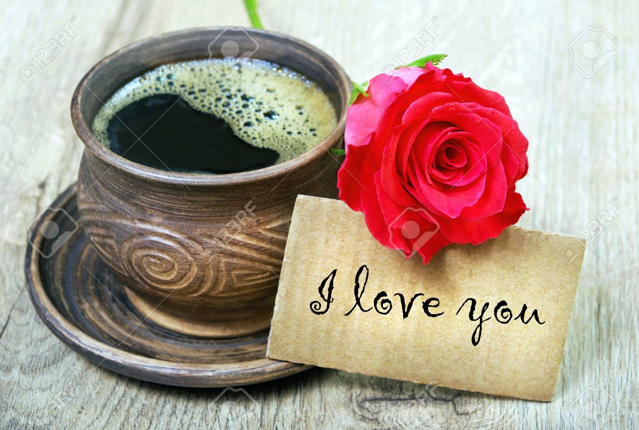 Good Morning A Cup Of Coffee And A Red Rose On A Wooden Table Stock