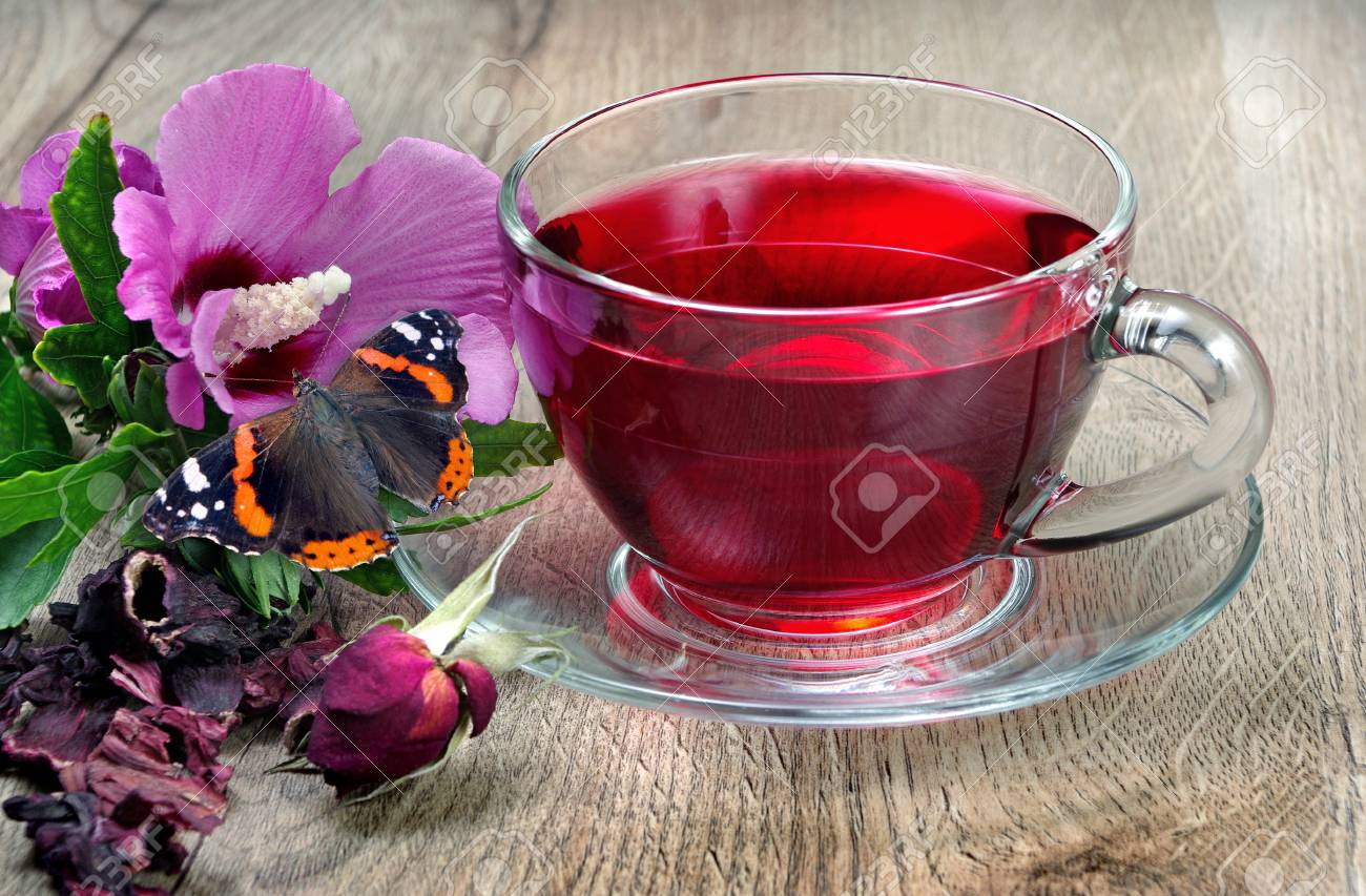 A Cup Of Tea On A Wooden Table Hibiscus Flower Vitamin Tea