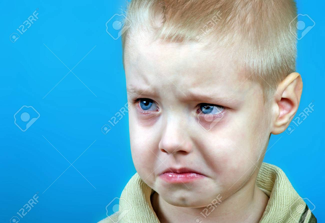 Portrait of offended little boy sad crying boy resentment emotion violence in family