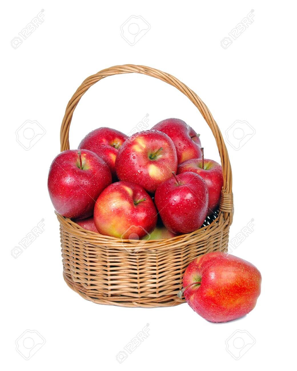 Red apples in wicker basket isolate on white - 123819200
