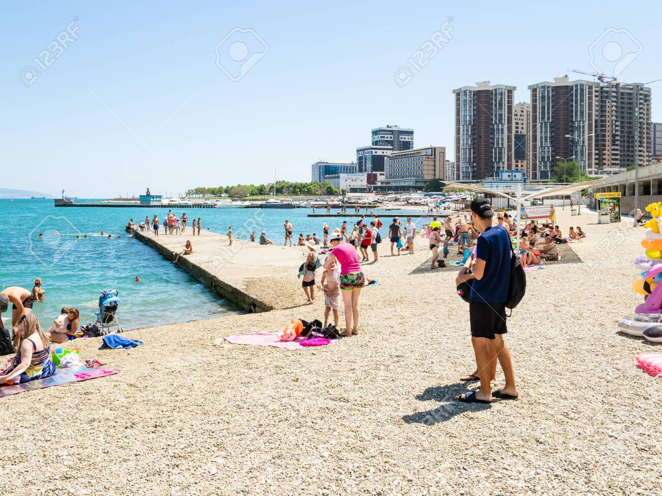 Novorossiysk Russia July 7 2019 People On Urban Beach Along Stock Photo Picture And Royalty Free Image Image 129058718