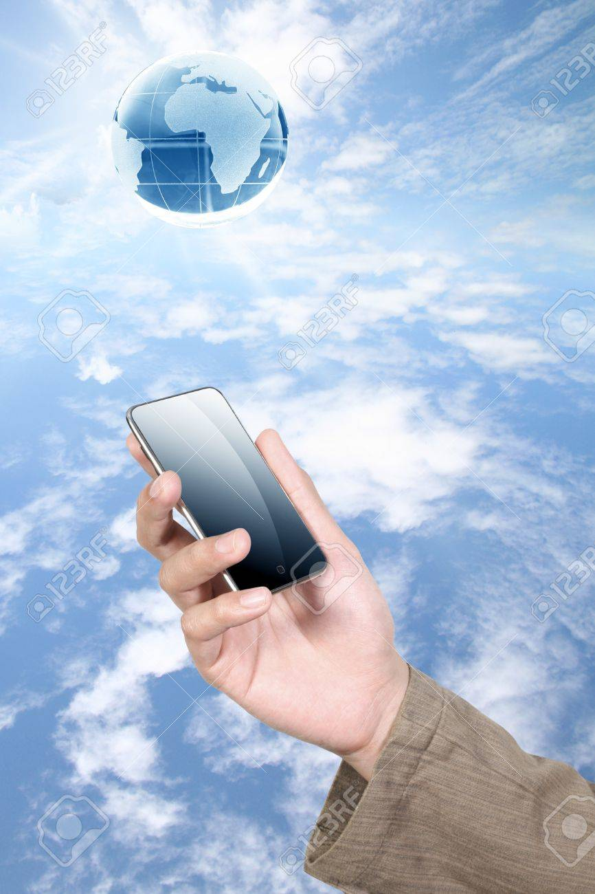 mobile phone with human hand on sky Stock Photo - 10334043