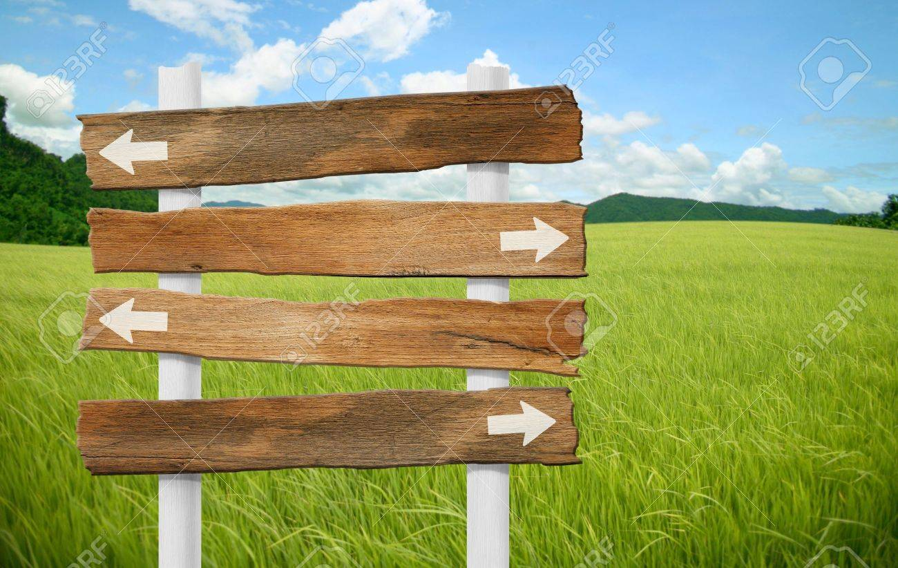 wooden sign on field grass mountain Stock Photo - 10710560