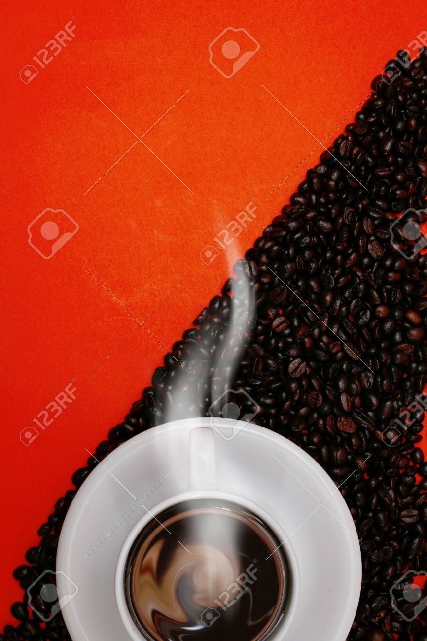 white coffee cup and beans on red background Stock Photo - 11851937
