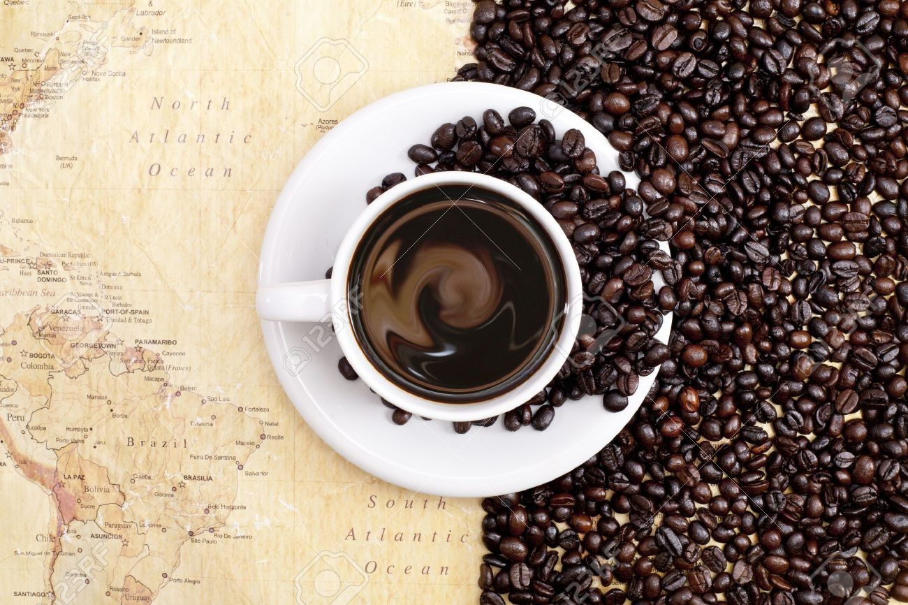 Stock Photo - coffee beans on Coffee Beans And Cup Background