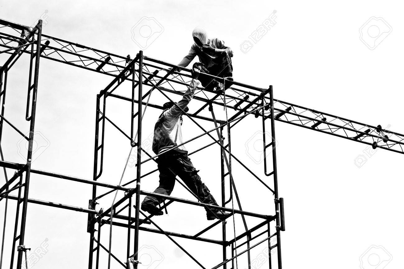 silhouettes of builders on scaffolding stock photo picture and silhouettes of builders on scaffolding stock photo 11971276