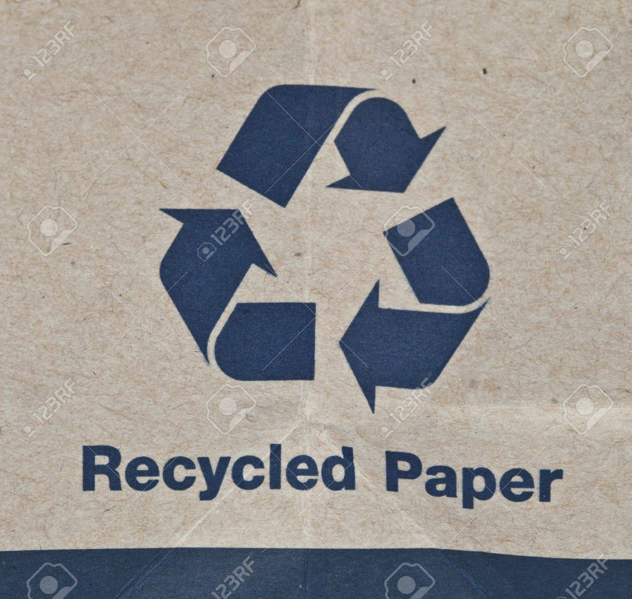 Paper recycled sign on grunge paper texture. Stock Photo - 13716355